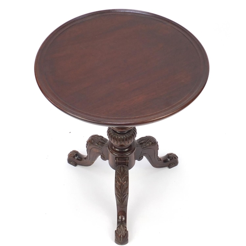 2059 - Mahogany dish top tripod occasional table, the knees carved with leaves, 63cm high x 51cm in diamete...
