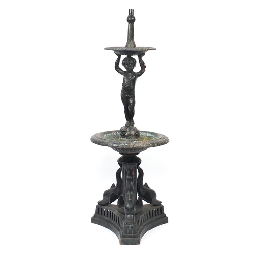 2008 - Victorian cast iron cherub water fountain with dolphin supports, 170cm high...