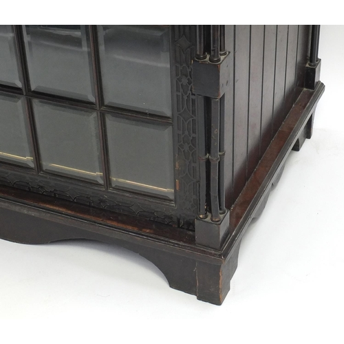 2001 - Chinese Chippendale design bookcase on stand with swan neck pediment, above a pair of glazed doors e...