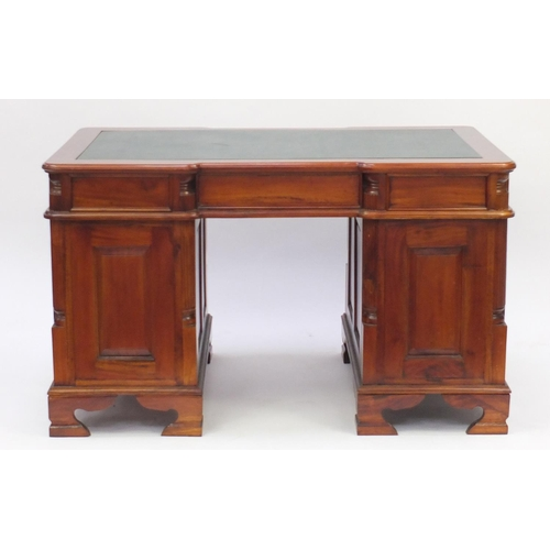 2009 - Mahogany twin pedestal desk with green leather insert, fitted with six drawers and a cupboard door, ...