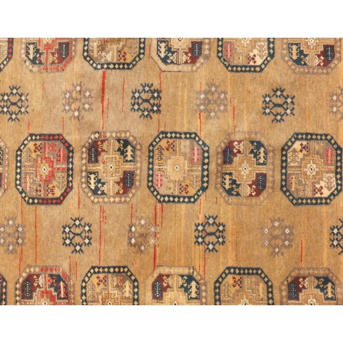 2023 - Rectangular Afghan Bokhara rug, the central field having a repeat floral design within corresponding...
