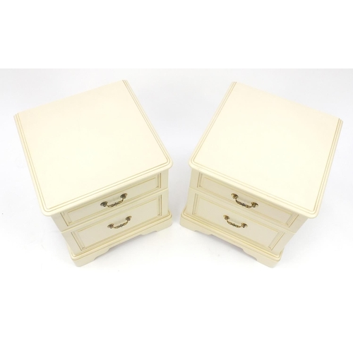 21 - Pair of cream painted wood two drawer bedside chests, 55cm H x 46cm W x 46cm D...