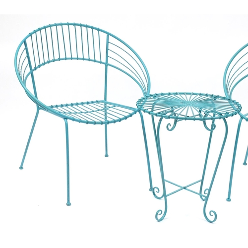 23 - Pair of turquoise painted metal tub chairs and matching side table...