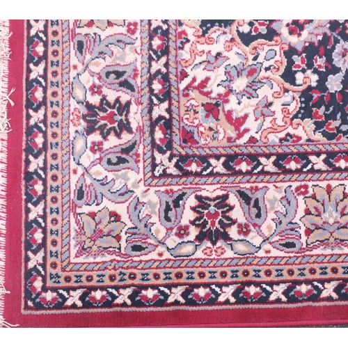 26 - Red and cream ground floral patterned rug, 325cm x 240cm...