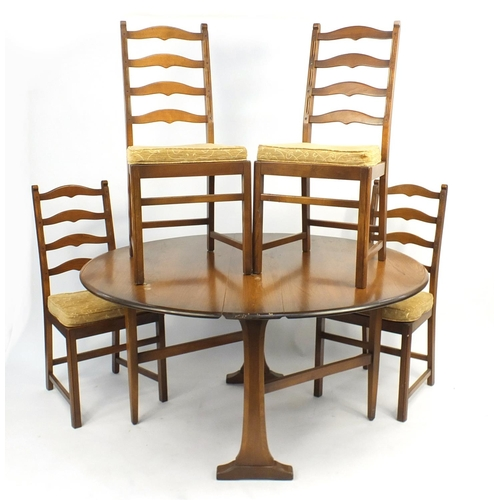 41 - Ercol drop leaf dining table with four ladder back chairs...