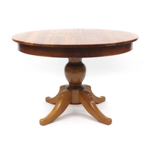 17 - Multi York circular extending dining table with two extra leaves and six upholstered chairs, the tab...