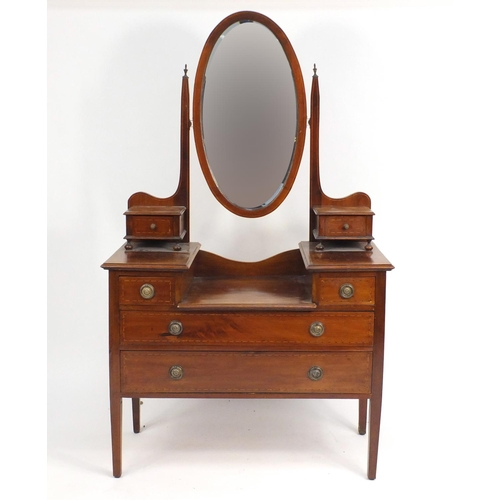 13 - Edwardian inlaid mahogany dressing table with swing mirror and two jewellery drawers a above an arra...