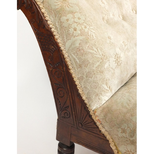 15 - Victorian walnut chaise lounge with carved decoration cream floral upholstery, 160cm in length...