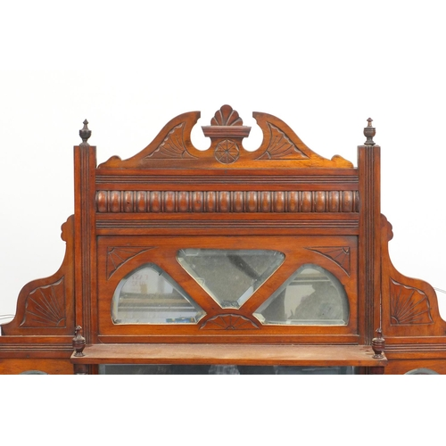 7 - Edwardian walnut over mantel mirror with bevelled glass and three shelves, 104cm H x 106cm W...
