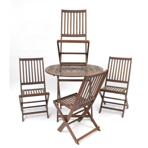 5 - Folding teak garden table and four chairs...