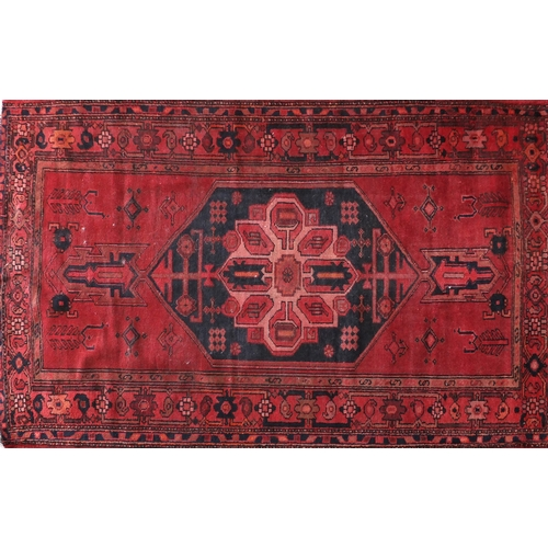 40 - Rectangular Persian Hamadan rug, having an all over geometric design onto predominantly red and blue...
