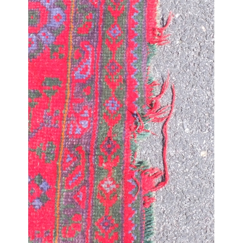 15A - Turkish Oushak carpet, decorated with geometric motifs onto a red ground, 400cm x 330cm...