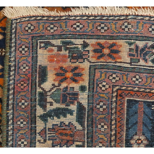 2056 - Rectangular North West Persian Yalameg rug, the central field having a flower and bird design onto a...