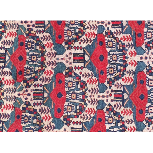 2039 - Rectangular Iran Afshar rug, having an all over stylised design, 145cm x 117cm...
