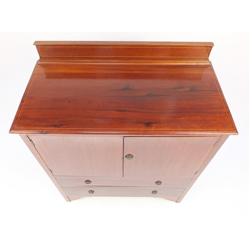 12 - Inlaid mahogany side cabinet with a pair of cupboard doors above two drawers, 110cm H x 91cm W x 46c...