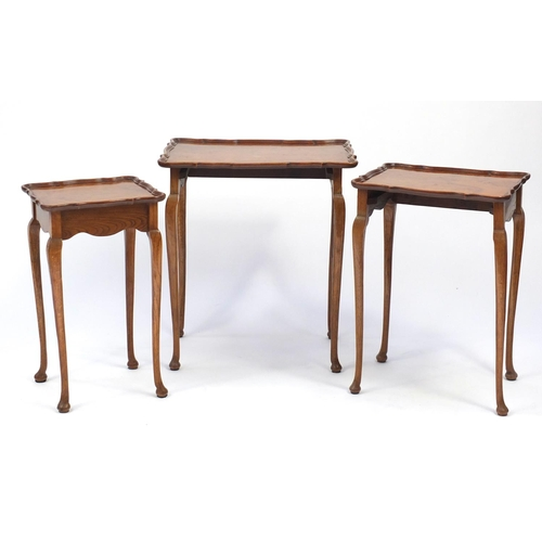 28 - Nest of three birds eye maple and oak occasional tables, the largest 60cm H x 54cm W x 41cm D...