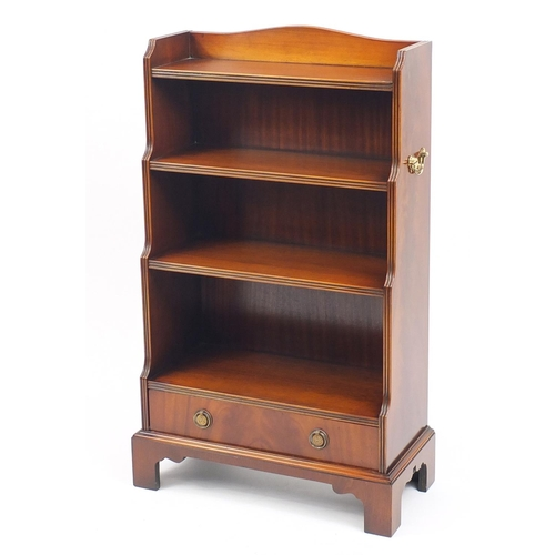 2059 - Good reproduction mahogany waterfall bookcase with base drawer and brass carrying handles, 104cm H x...