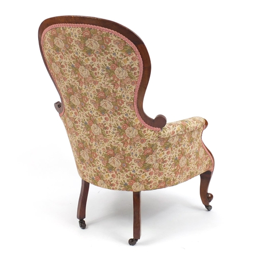 2009 - Victorian mahogany framed spoon back fireside chair, with pink floral upholstery...