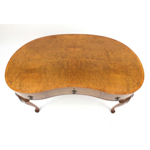 2022 - Waring & Gillow walnut kidney shaped dressing table with three drawers, on carved cabriole legs, 76c...