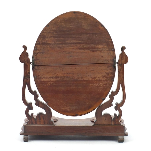 14 - Victorian walnut swing mirror with two hinged compartments, 64cm high...