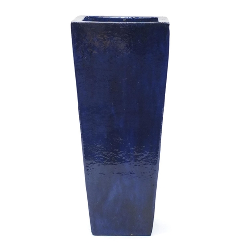2073 - Tall blue glazed planter of tapering form, 90cm high x 40cm sq...