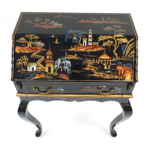 2024 - Chinese black lacquered bureau, hand painted with figures in a river landscape with pagodas, the fal...