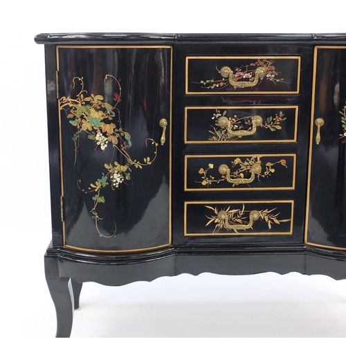 2012 - Chinese black lacquered side cabinet, hand painted with birds of paradise amongst flowers, fitted wi...