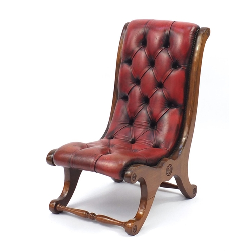 2036 - Mahogany framed and oxblood leather button back sleigh chair, 78cm high...