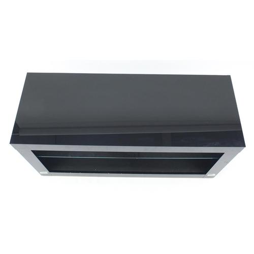 47 - Contemporary black gloss multi media stand with glass shelf, 53cm H x 110cm W x 42cm D...