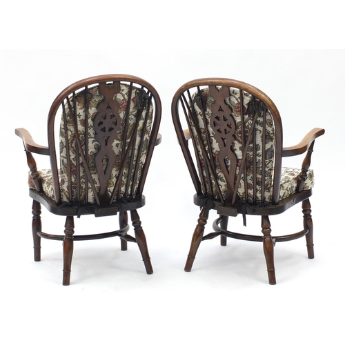 45 - Pair of oak wheel back chairs with crinoline stretchers...