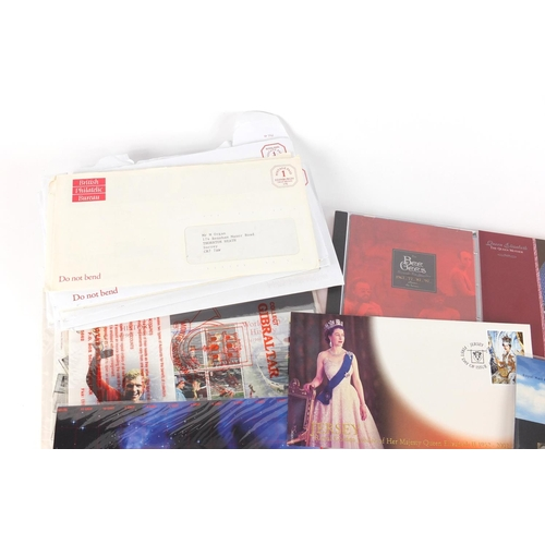641 - Royal Mail presentation packs and a Queen Elizabeth Century five pound coin...