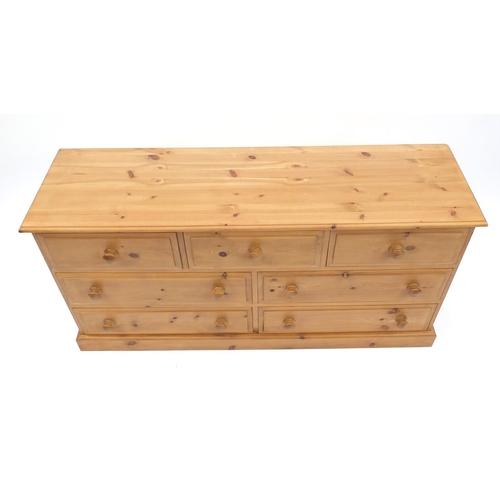 2052 - Pine seven drawer chest, 75cm H x 147cm W x 42cm D...