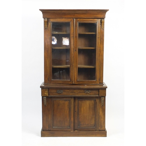 20 - Victorian mahogany display case with a pair of glazed doors, enclosing three shelves above a frieze ...