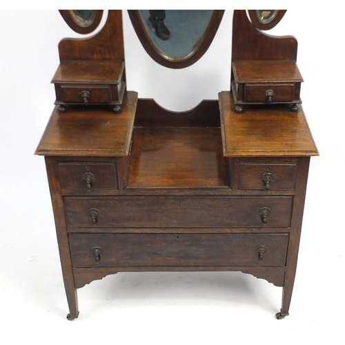 40 - Oak dressing table with triple aspect mirror above a series of six drawers, 172cm H x 92cm W x 46cm ...