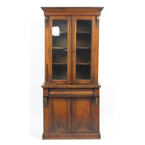 5 - Victorian mahogany display case with a pair of glazed doors, enclosing three shelves above a frieze ...