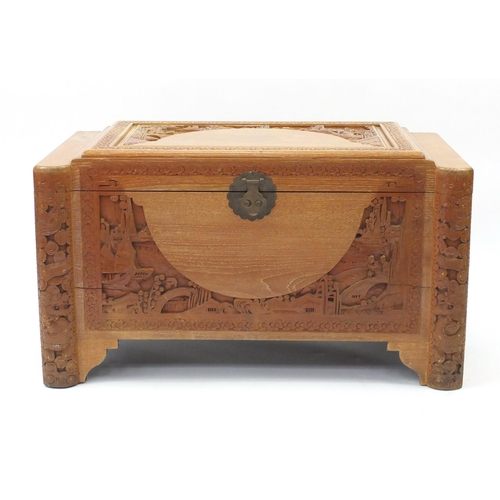 2 - Chinese camphor wood trunk carved with figures, junks and dragons, 58cm H x 100cm W x 50cm D...