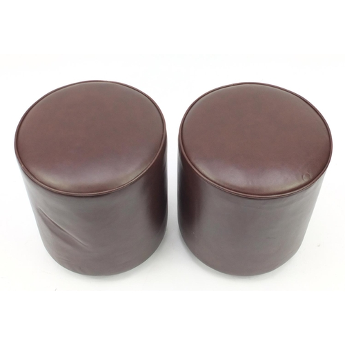 31 - Pair of cylindrical brown leather stools by RHA furniture, each 45cm high x 39cm in diameter...