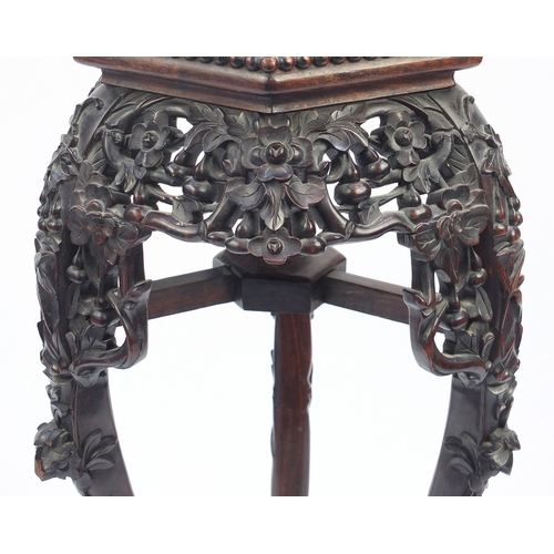 11 - Chinese hexagonal carved hardwood plant stand with inset marble top, 91cm high...