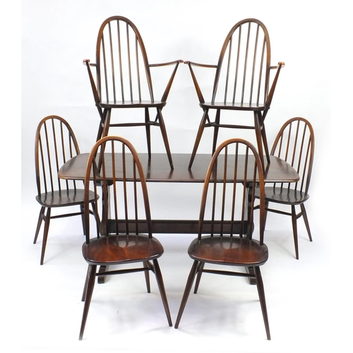 21 - Ercol dark elm dining table and six stick back chairs including two carvers, the table 72cm H x 152c...