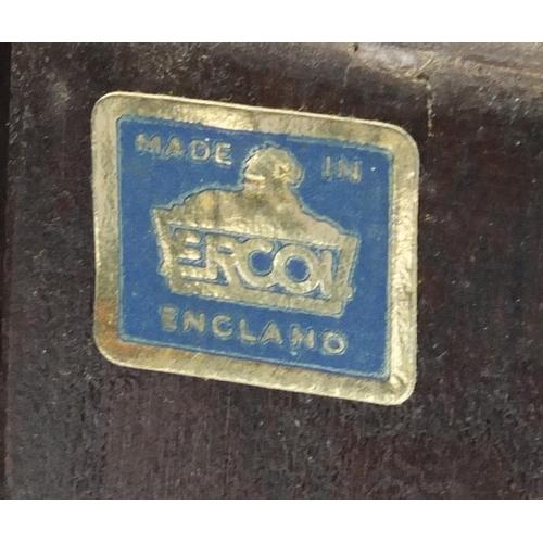 43 - Ercol dark elm corner cupboard fitted with three open shelves, above a cupboard door, 184cm H x 76cm...