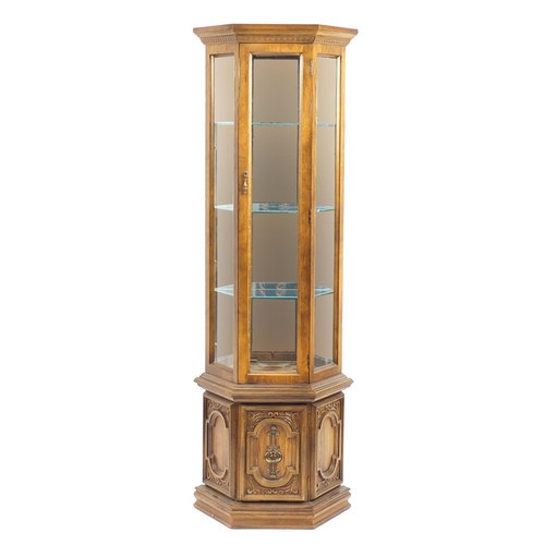 2052A - American walnut display cabinet a central door enclosing three shelves and mirrored back, above a cu...
