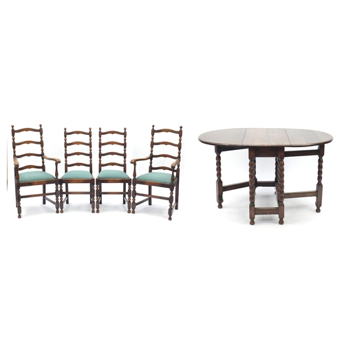 46 - Oak gate leg dining table with bobbin supports and set of four wavy ladder back chairs including two...