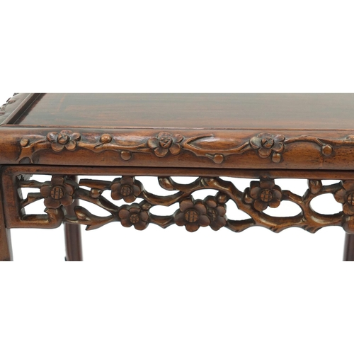 2005 - Chinese rosewood quartetto nest of occasional tables carved with flowers, the largest 72cm H x 50.5c...