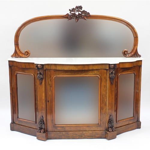 2001 - Victorian walnut serpentine fronted credenza, with mirrored back and marble top above three glazed d...