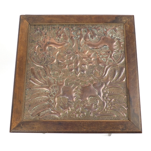 2050 - Oak Arts & Crafts centre table with inset copper panel embossed with stylised dragons, 62cm H x 45cm...