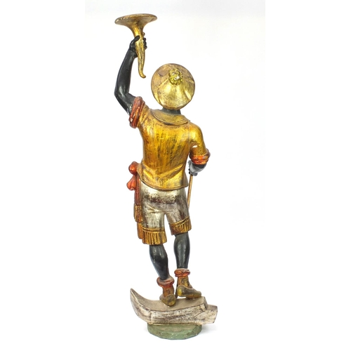 2003 - 19th century Venetian gesso and carved wood Blackamoor holding a torch aloft standing upon a gondola...