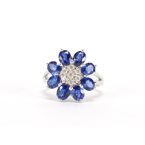 2473 - 9ct white gold blue stone and diamond flower head ring, size N, approximate weight 5.5g...