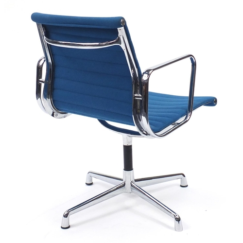 2034 - Charles and Ray Eames EA107 design desk chair with turquoise upholstery, 82cm high...