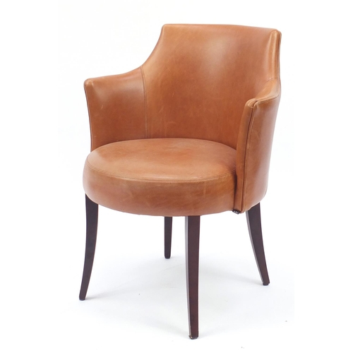2043 - Contemporary Morgan tan leather chair on out swept tapering legs, 81cm high...