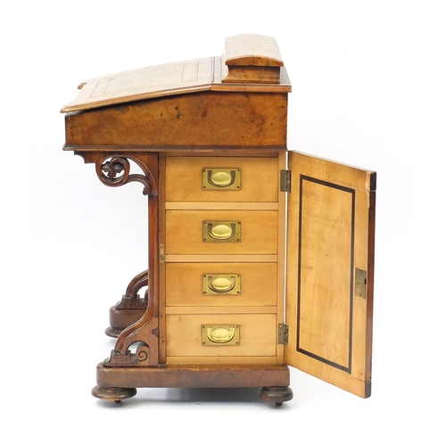 2032 - Victorian inlaid walnut davenport, the lift lid with tooled leather insert above a panel door, side ...